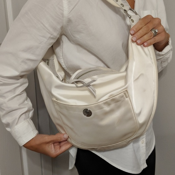 Coach Handbags - Coach white sateen hobo bag with suede trim on zip